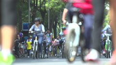 BPMX85-Mexico, hundreds of bikes on street. Low angle, wide, selective focus. - stock footage