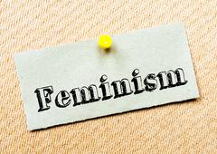 Recycled paper note pinned on cork board. Feminism Message. Concept Image Stock Photos