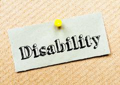 Recycled paper note pinned on cork board. Disability Message. Concept Image - stock photo