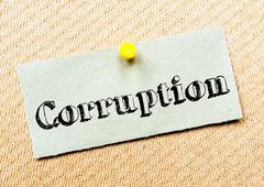 Recycled paper note pinned on cork board. Corruption Message. Concept Image - stock photo