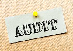 Recycled paper note pinned on cork board. Audit Message. Concept Image - stock photo