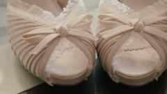 Pair of bride's/bridal shoes close up detail tracking motion Stock Footage