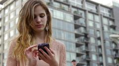 Hipster Swipes Through Her Phone Photos And Smiles And Laughs Stock Footage