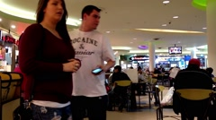 Close up man enjoying meal in mall food court cafeteria. Stock Footage