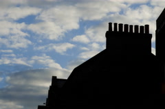 4k Time Lapse in silhouette english roof and clouds Stock Footage