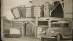 1869 - cotton bales ready for shipping to textile plant -vintage film home movie Stock Footage