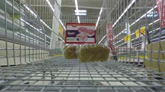 Filling cart with food in supermarket, time-lapse. Stock Footage