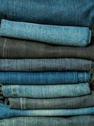 folded jean stack close up - stock photo