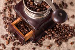 Antique coffee grinder and coffee beans Stock Photos