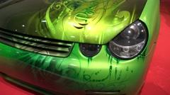 4k Small car amazing poison green airbrush design Motorshow Stock Footage