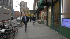 Walking in downtown New York in the afternoon Stock Footage