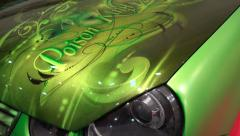 4k Small car amazing poison green airbrush design Motorshow Stock Footage