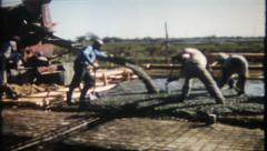 1880 - workers spread concrete for floor on new home - vintage film home movie Stock Footage