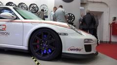 Stock Video Footage of 4k Carbon Porsche side view blue brakes Motorshow panning shot