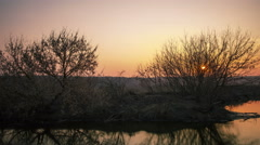 Orange sunrise near river Landscape. 4K ( 4096x2304)    time lapse without birds - stock footage