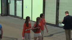 Young group of friends talking and walking Stock Footage