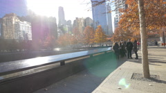 Sunny afternoon at the National September 11 Memorial Fountains New York Stock Footage