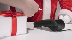 Santa Claus behind the counter using credit card reader Stock Footage