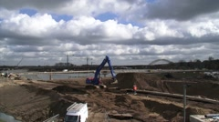 Excavator digging at construction site Room for the river Waal Stock Footage