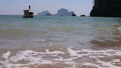 Motor thai longtail boat drifts at sea coast Stock Footage