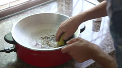 man sponges down frying pan quickly - stock footage