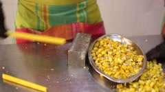 Worker cuts the long candy into small pieces Stock Footage