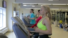 Training on the treadmill in the fitness club Stock Footage