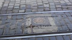Metal pole leaves the earth blocks the path of cars and trolleys Stock Footage