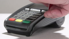 Hand swiping debit card through credit card terminal and entering PIN code Stock Footage