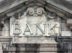Weathered bank sign on building Stock Photos