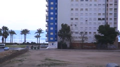 Spain. City Cullera. views of the building of hotel, swaying palm trees. Sea in Stock Footage