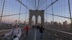 4K video - Riding bike and walking on Brooklyn Bridge New York City Stock Footage
