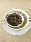 Peppermint tea in tea strainer Kuvituskuvat