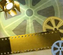 Vintage film strip background with reels and reflector Stock Illustration