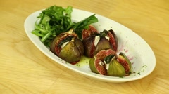 Figs stuffed with arugula Stock Footage