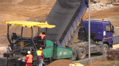 Stock Video Footage of People work with asphalt pavement machines in construction site