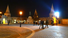 People visit the Fisherman's Bastion in Budapest at night Stock Footage