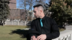Young man in a city park - stock footage