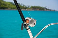 Fishing rod and reel on a boat - stock photo