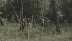 Africa children collecting wood forest pan Stock Footage