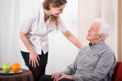 Nurse caring about elder man Kuvituskuvat