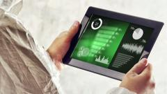 Chemical Scientist Analyzing Experiment Results Charts on Digital Tablet Stock Footage