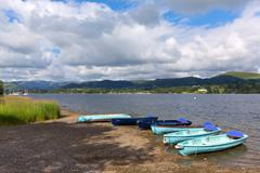 Wooden dinghy rowing boats in the Lake District Ullswater England UK - stock photo