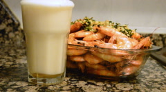 Beer Pouring Out Of Cold Glass With Shrimps Stock Footage