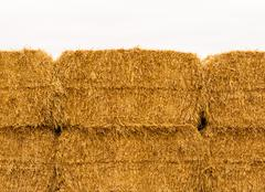 Close-up of yellow stacked hay bales - stock photo