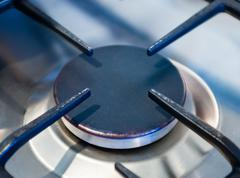 Close-up of metallic kitchen stove burner - stock photo