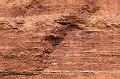 Red sedimentary clay background eroding Stock Photos
