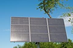 Sulight Reflecting on Solar Panel - stock photo