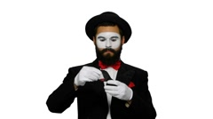 Man mime looks uses magnifier on white background Stock Footage