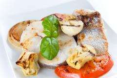 Slice of hake grilled Stock Photos